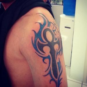 Tribal Flame Tattoos on Arm